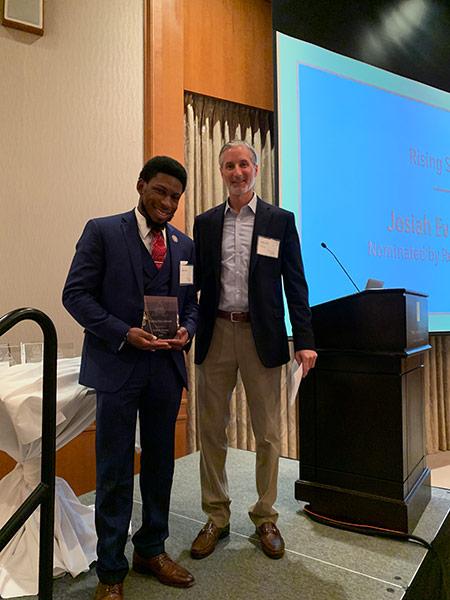 Josiah Evans receiving award