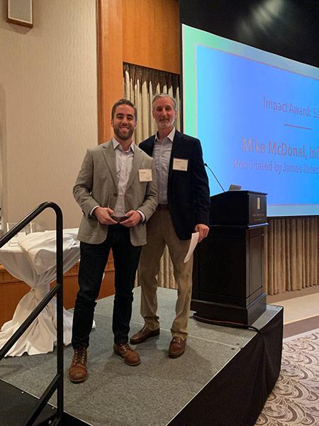 Mike Mcdonel receiving award